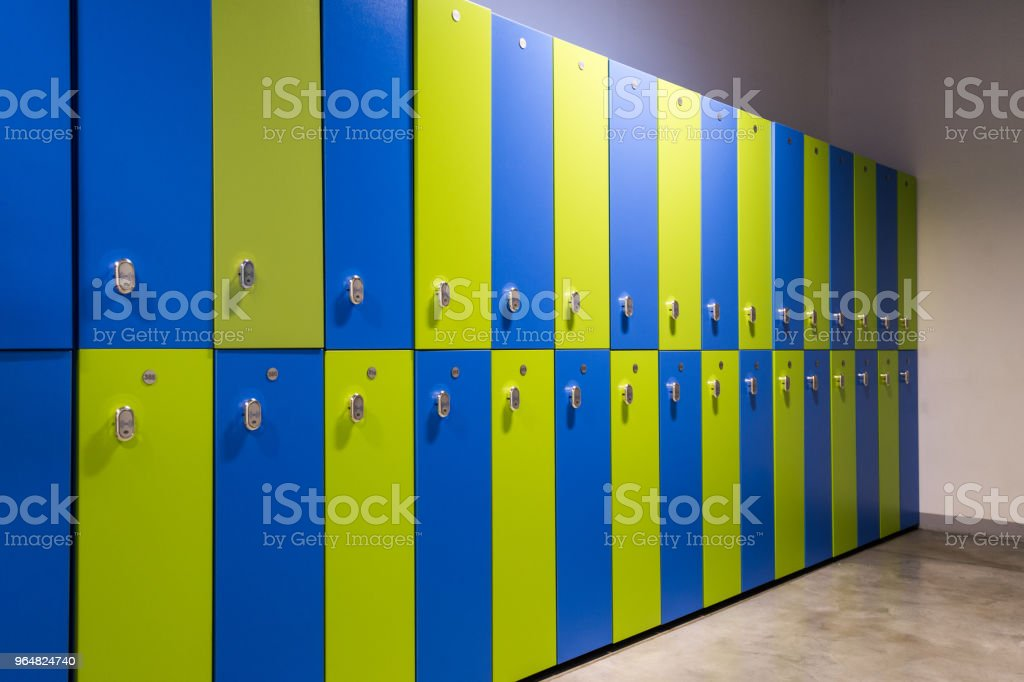Green and blue clothes locker room in a gym or sports center royalty-free stock photo