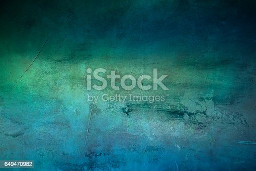 649470770 istock photo green and blue textured background with spotlight 649470982