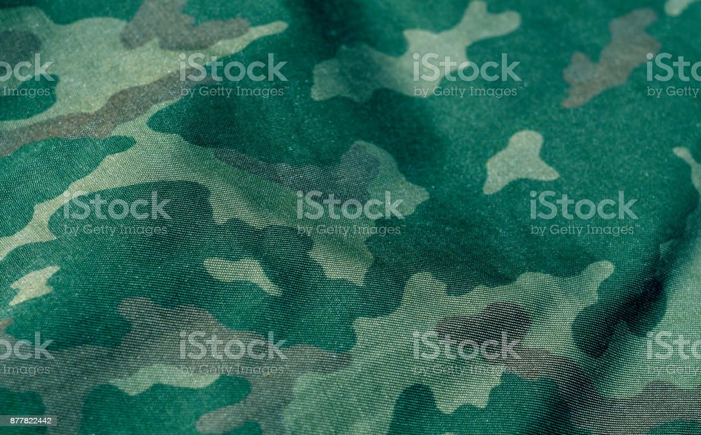Green and brown color military uniform pattern with blur effec stock photo