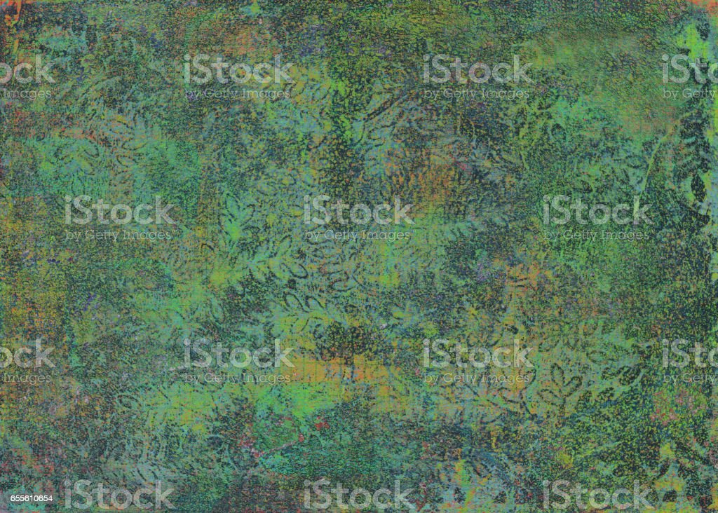 A green and brown hand painted mottled texture with slight floral pattern stock photo