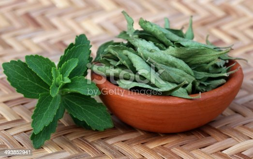 istock Green and dired Stevia leaves 493852941