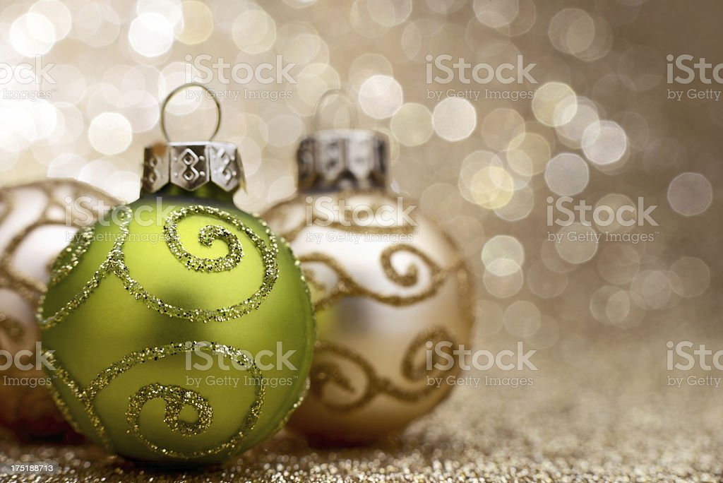 Green and gold christmas ball on illuminated background royalty-free stock photo