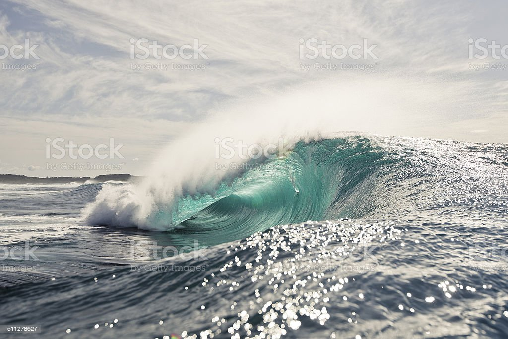 Green and gold morning wave stock photo