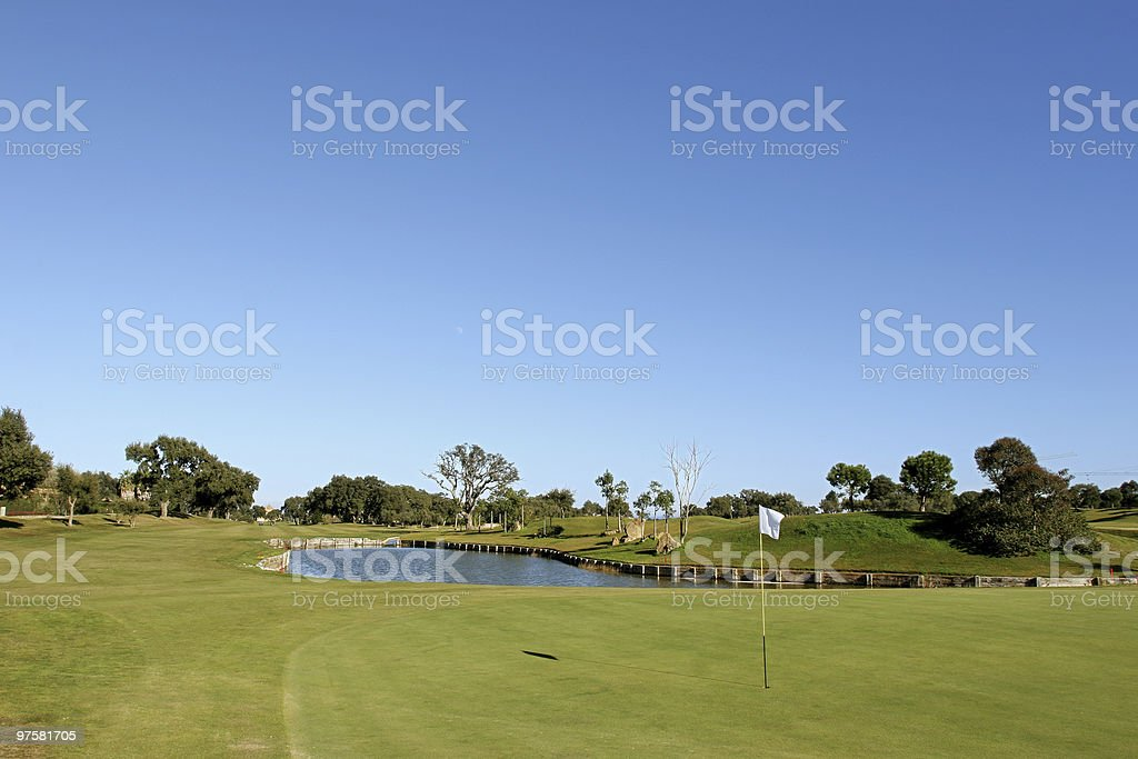 Green and lake on golf course in the sun royalty-free stock photo