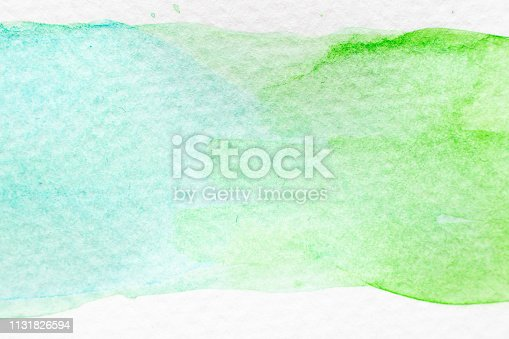 847999586 istock photo Green and light blue color watercolor handdrawing as brush or banner on white paper background 1131826594