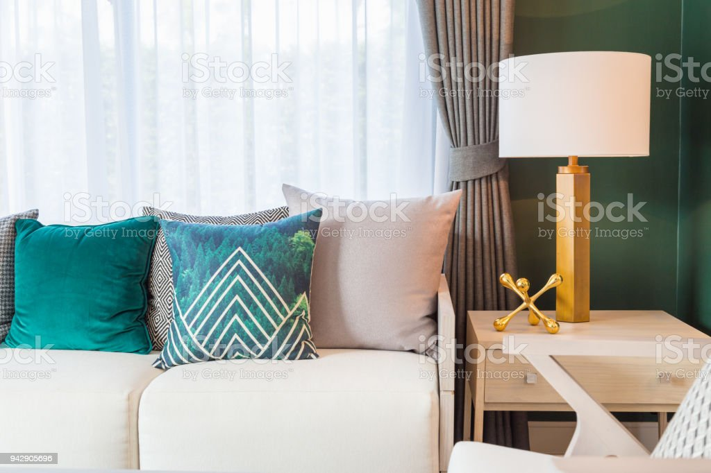 Wondrous A Green And Light Brown Pillows On Sofa With Luxury Lamp On Lamtechconsult Wood Chair Design Ideas Lamtechconsultcom