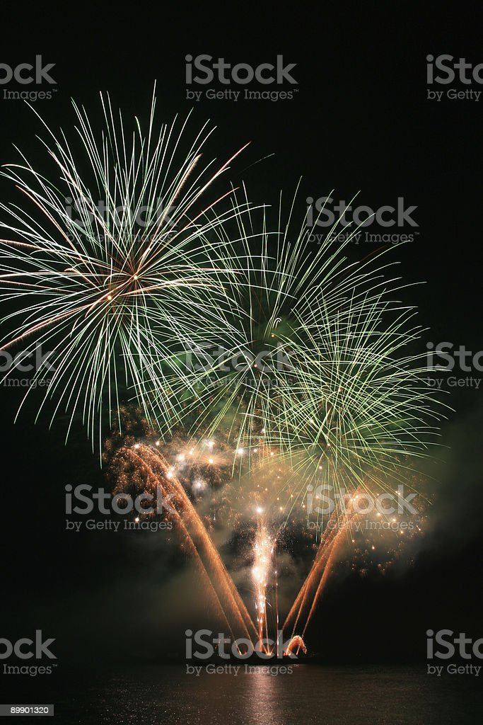 green and orange fireworks royalty free stockfoto