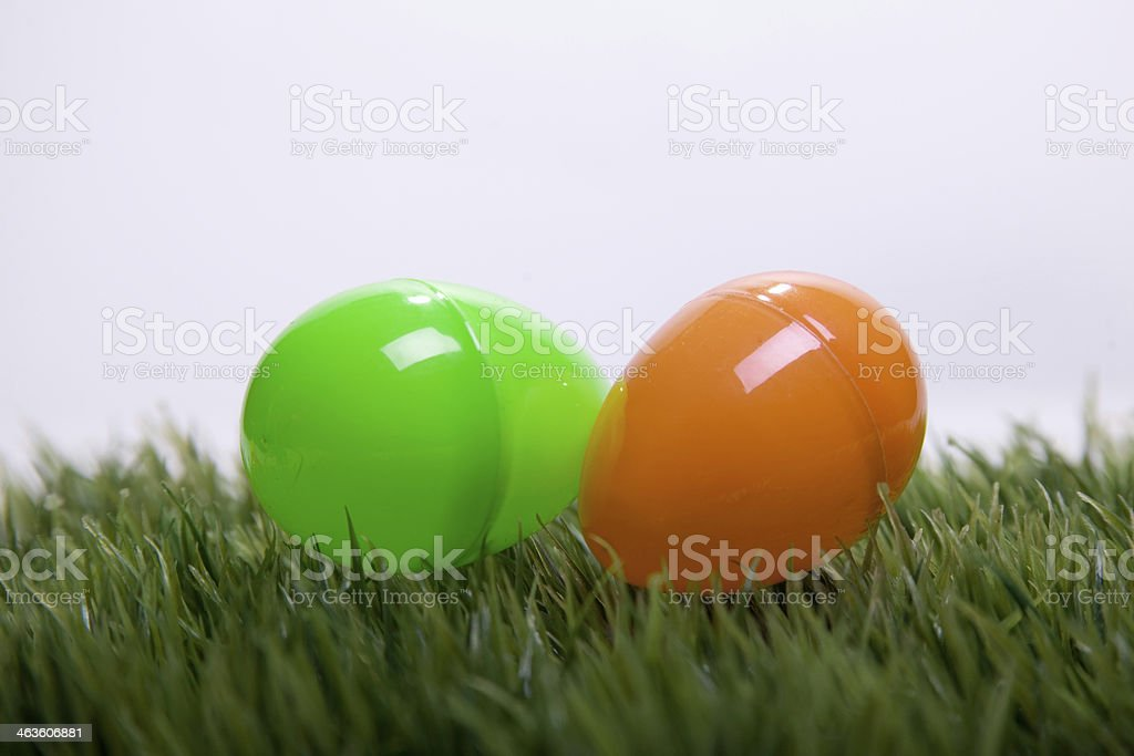 Green And Orange Plastic Easter Eggs On Grass Royalty Free Stock Photo