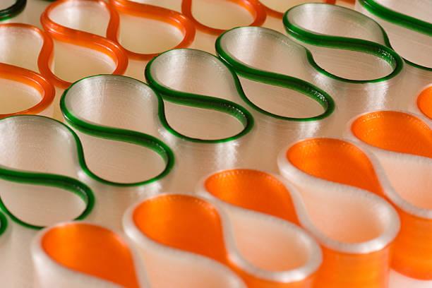 Green and Orange Ribbon Candy stock photo