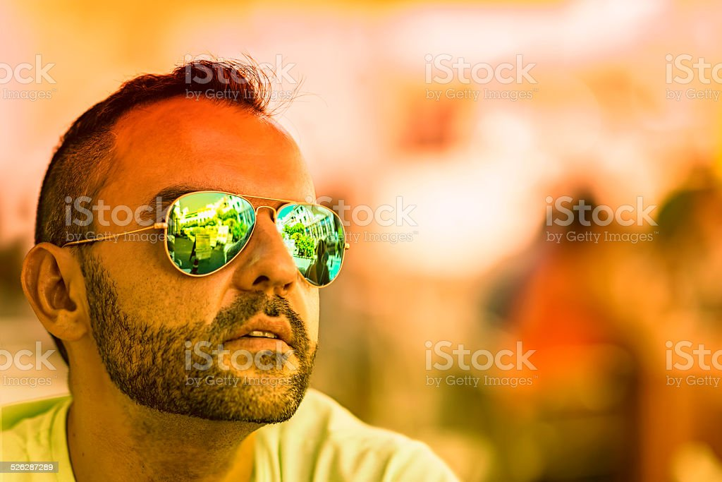 Green and orange sunglasses stock photo