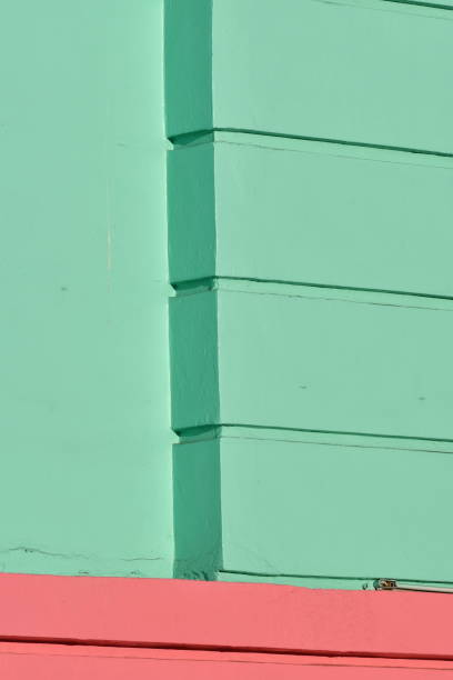 green and pink building exterior - steven harrie stock photos and pictures