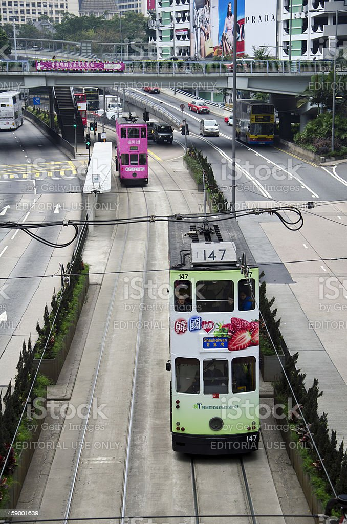 Green and Pink Trams in Hong Kong stock photo