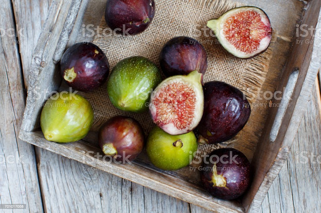 Green and purple figs stock photo