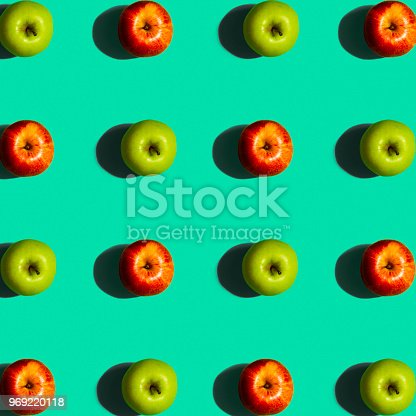 istock Green and Red Apple Pattern on a Blue Background 969220118