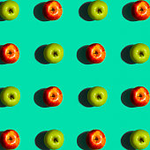 Green and Red Apple Pattern on a Blue Background Flat Layout