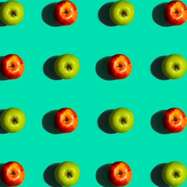 Green and Red Apple Pattern on a Blue Background stock photo