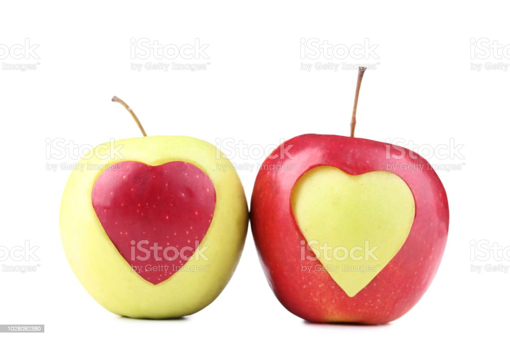 Green And Red Apple With Cutout Heart Shape On White