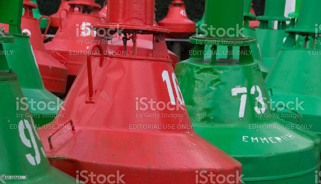 Green and red beacon bouy in Emmerich stock photo