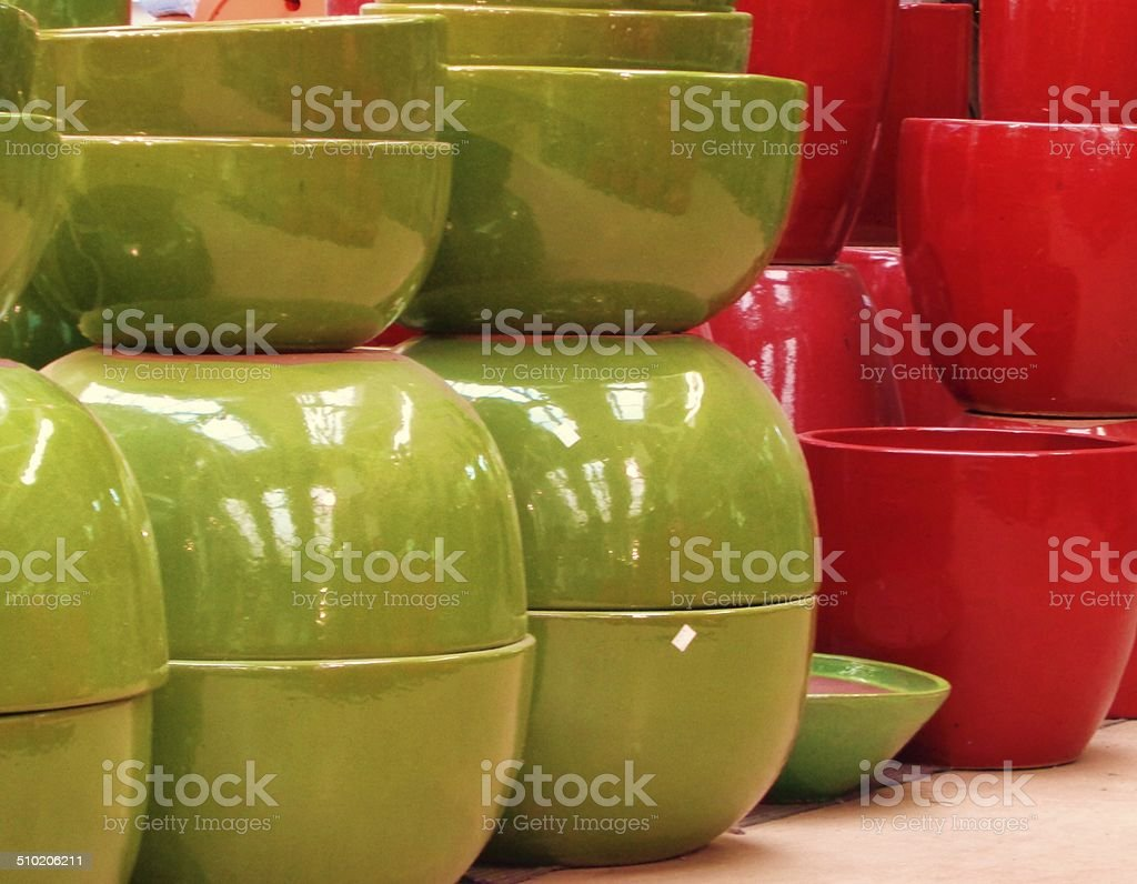Green and Red ceramic planters stock photo