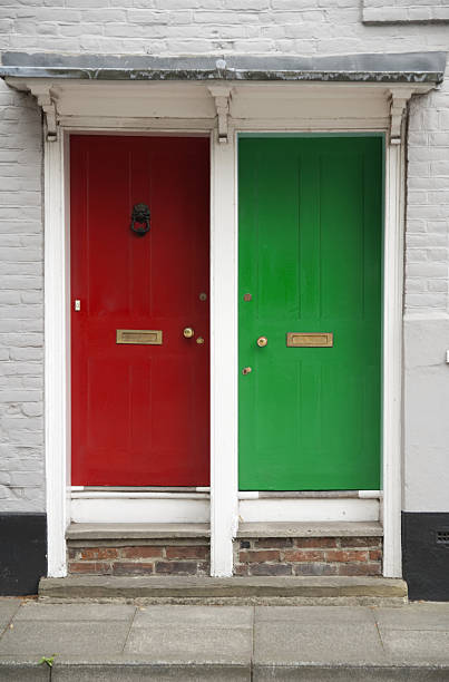 green and red door - symmetry stock photos and pictures