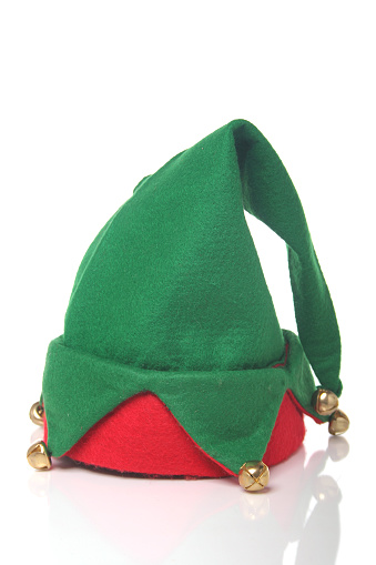 Christmas elf hat. Taken in studio against white background and reflective surface
