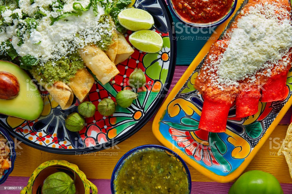 Green and red enchiladas with mexican sauces stock photo
