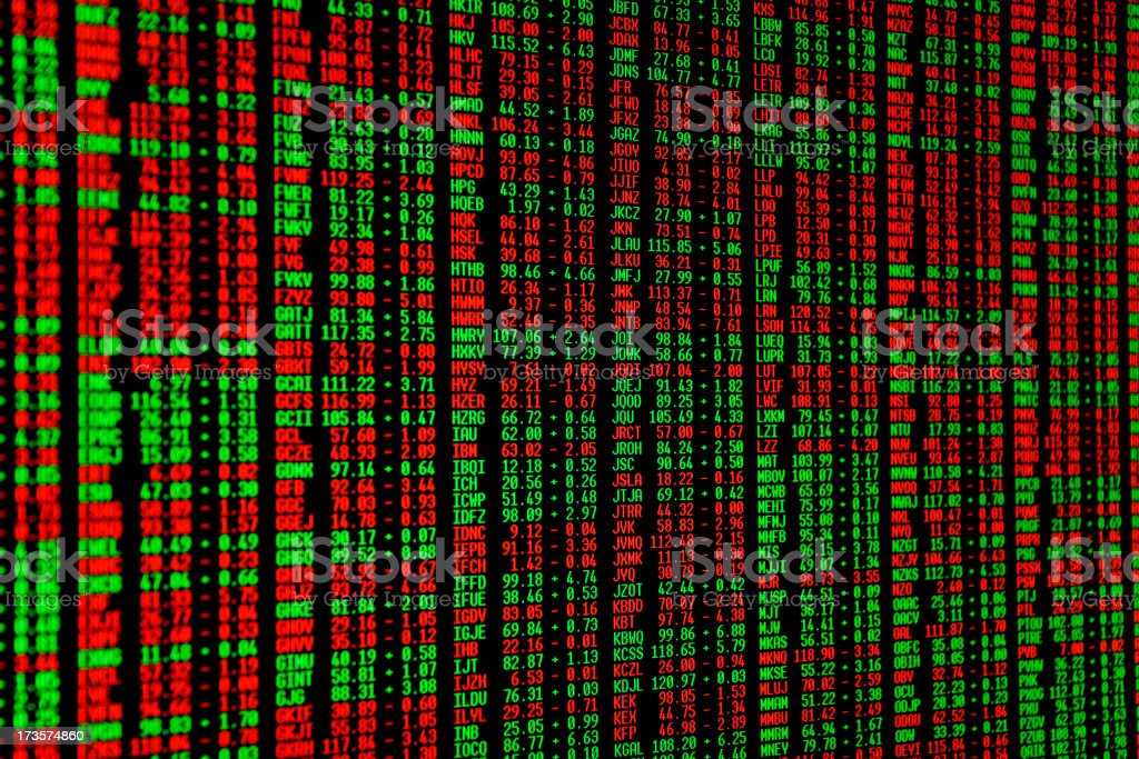 Green and red numbers on the stock market screen stock photo