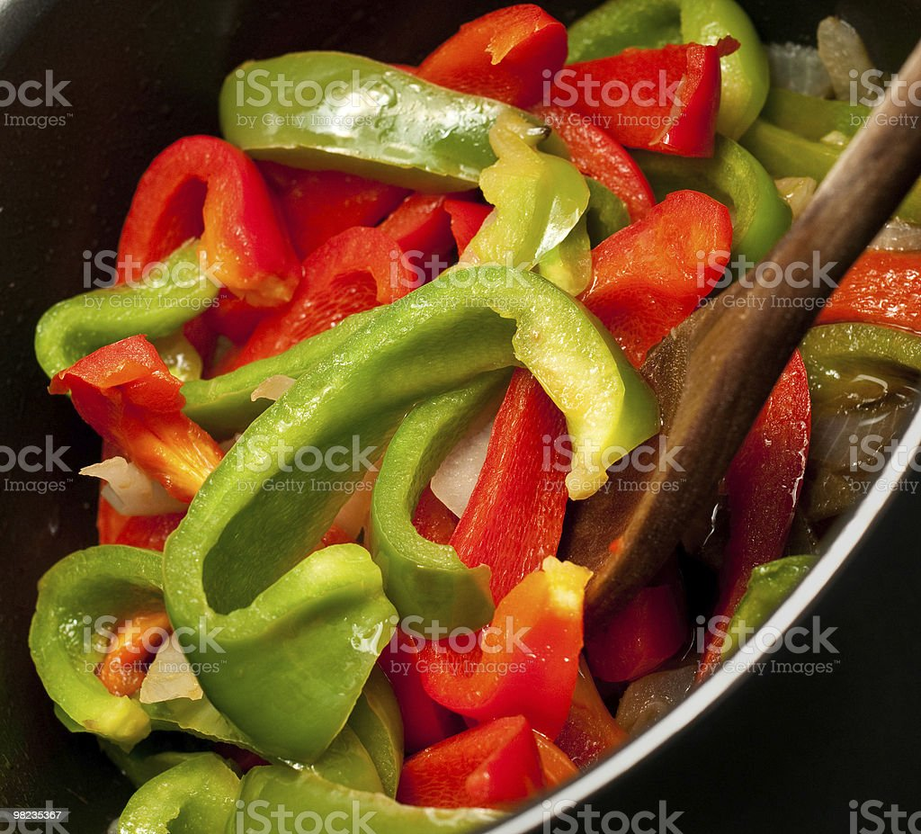 Green and red pepper cooking royalty-free stock photo