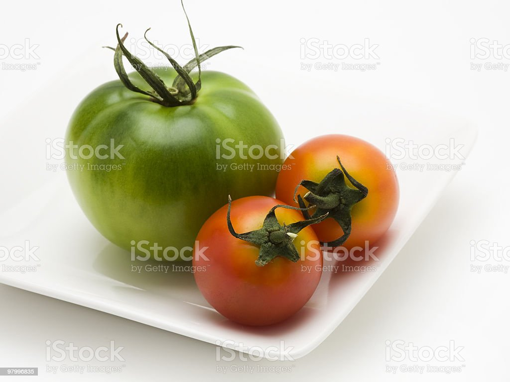 Green and red tomatoes royalty free stockfoto