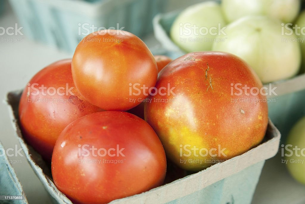 Green and Ripe Tomatoes at the Farmer's Market royalty-free stock photo