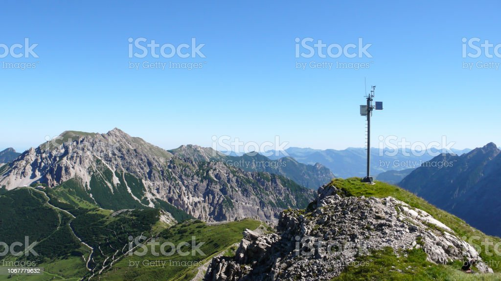 green and rocky mountain landscape in the Swiss Alps with a weather...