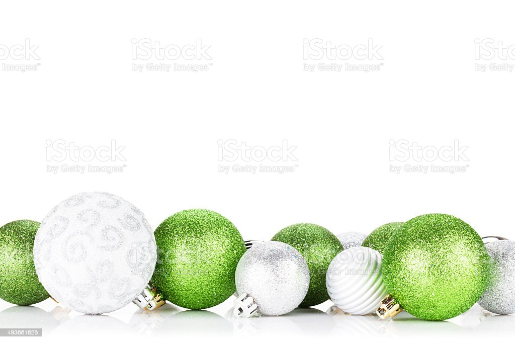 Green and silver christmas baubles stock photo