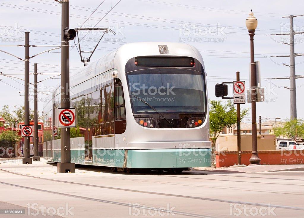 A green and white car of the Phoenix Metro Light Rail Train stock photo