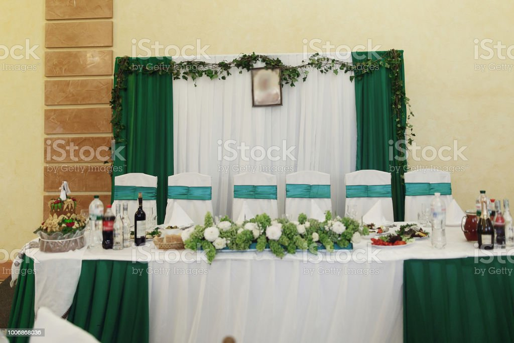 Green And White Color Theme At Wedding Reception Head Wedding Table