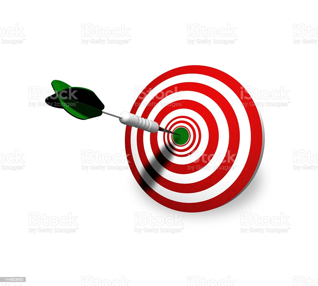 A green and white dart hitting the bull's-eye of a target stock photo