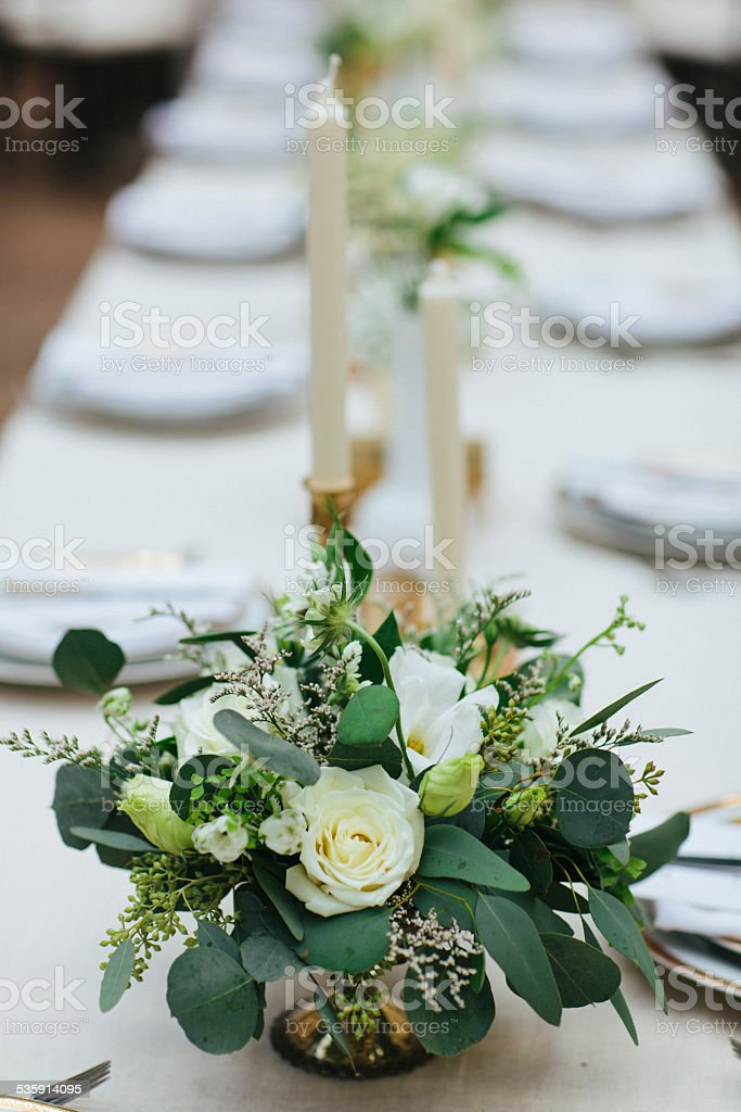 Green and white flower arrangement on dining table stock photo green and white flower arrangement on dining table royalty free stock photo mightylinksfo