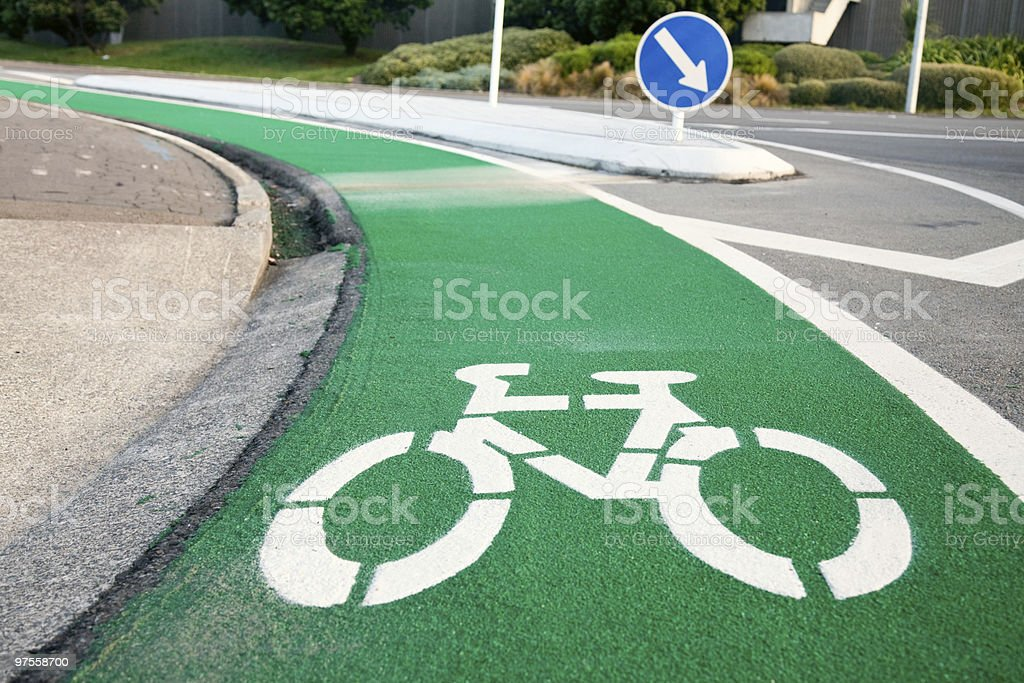 A green and white lane for bicycles royalty-free stock photo