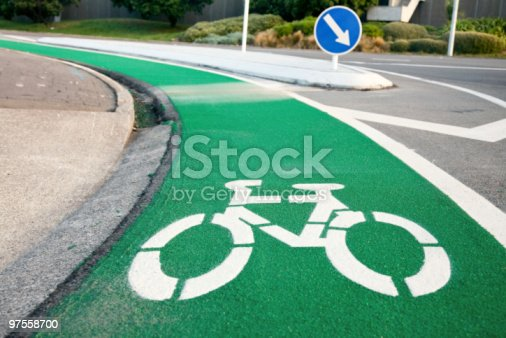 A Green And White Lane For Bicycles Stock Photo & More Pictures of Asphalt