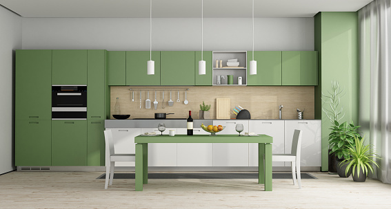 Green and white modern kitchen with dining table - 3d rendering Note: the room does not exist in reality, Property model is not necessary