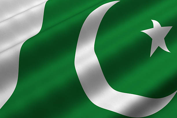 green and white pakistani flag with white moon and star - pakistani flag stock photos and pictures