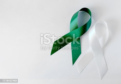 istock Green and White symbolic ribbon - the problem of organ donation, mental health. Teen suicide. On a White background 1218432463