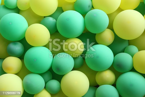 Green and yellow balloons as background.