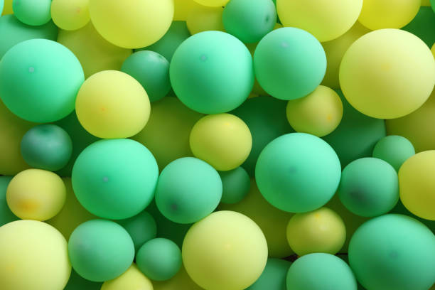 Green and yellow balloons stock photo