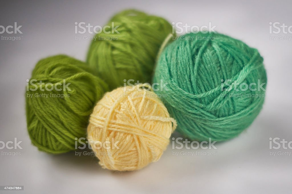 green and yellow balls of yarn royalty-free stock photo