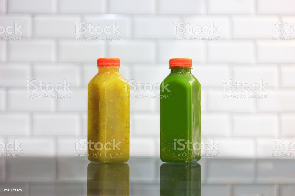 Green and yellow chia seeds cold pressed juices stock photo