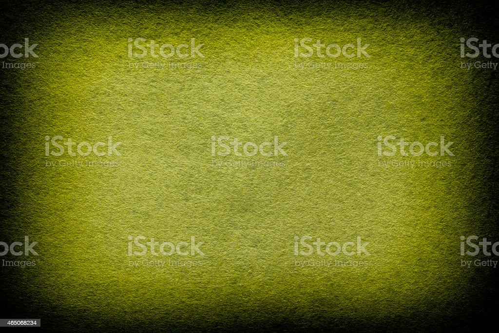 Green and yellow felt background stock photo
