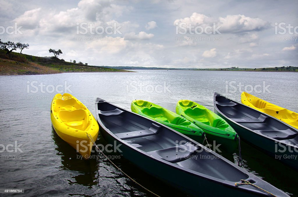 Green and yellow kayaks stock photo