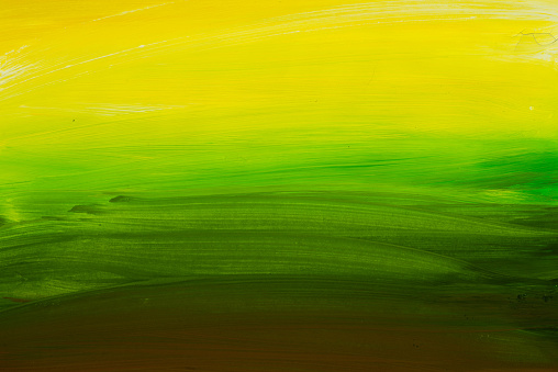 1084390994 istock photo green and yellow painted background texture 684152702
