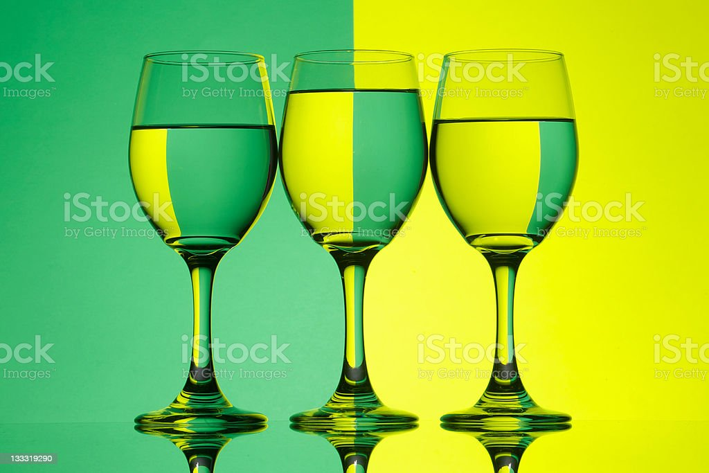 Green and Yellow Reflected in Glasses of Water stock photo