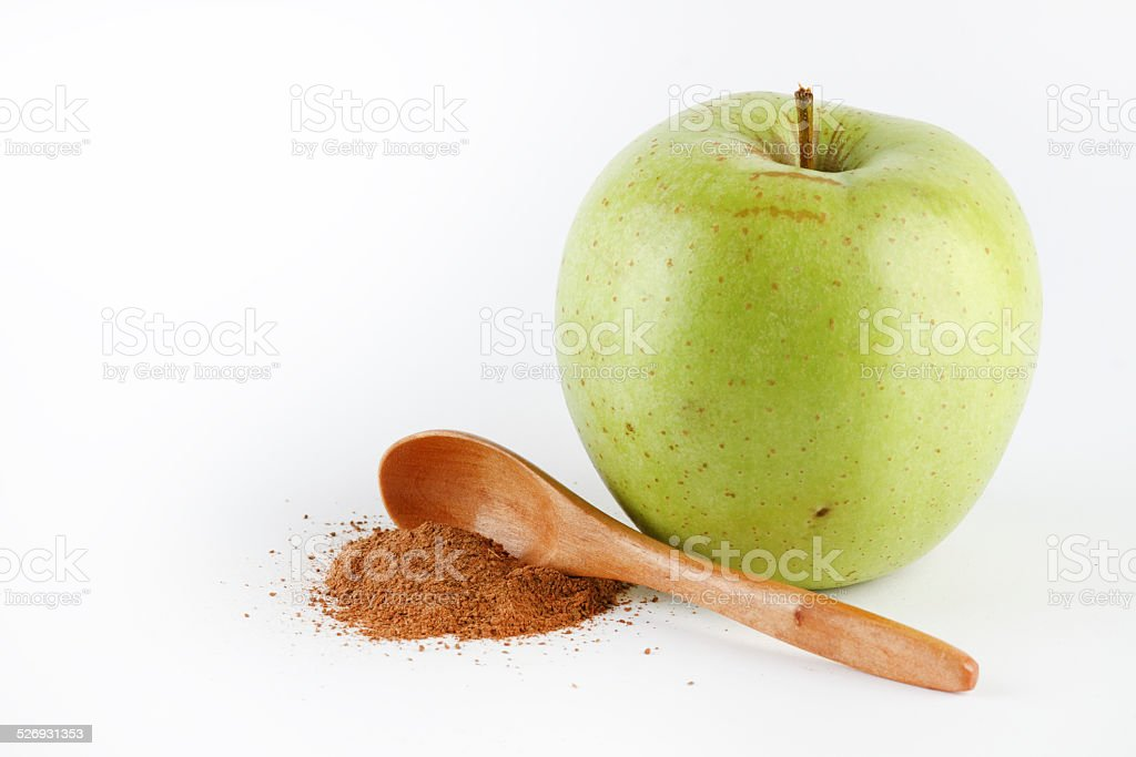 Green apple and cinnamon powder stock photo